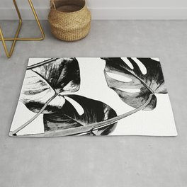 Black monstera leaves watercolor Rug
