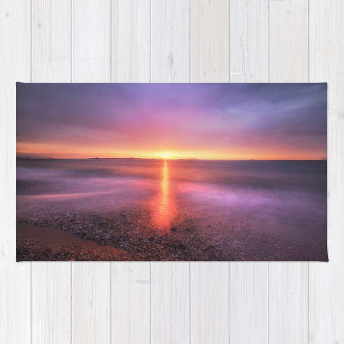 Bright sunset against dramatic sky Rug