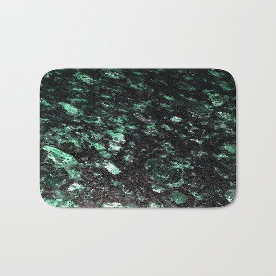 The Jade Sleeping Beneath the Black Granite Bath Mat