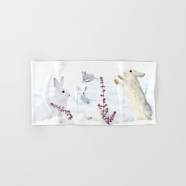 White rabbits dancing around red erica in snow mountain. Hand & Bath Towel