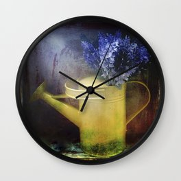 One yellow watering can with violet flowers Wall Clock