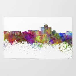 Tucson skyline in watercolor background Rug