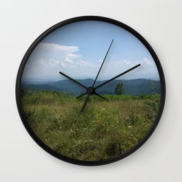 Meadow and mountains in the distance Wall Clock