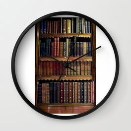 vintage Old Leather bound books in a bookcase Wall Clock