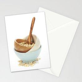 bowl of oat flake on white background Stationery Cards