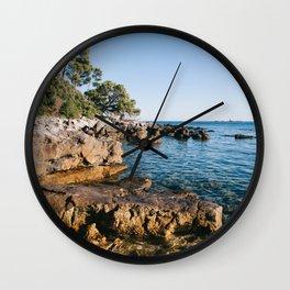 Sunset on the wild beach in Rovinj Wall Clock