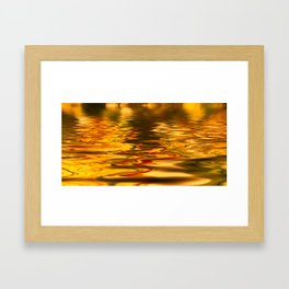 bstract image of light reflected on gold color water Framed Art Print
