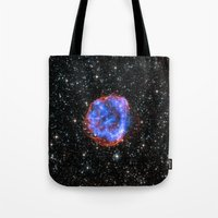 nasa Tote Bags featuring NASA Chandra X Ray Observatory by Artlala for MSF Doctors Without Borders