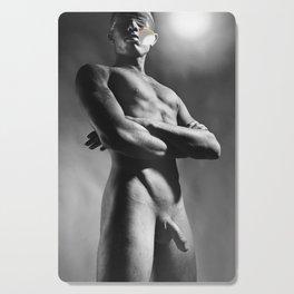 Naked man blindfolded Cutting Board