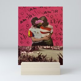 LOVE-AMOR, boy and girl kissing in front of a lake Mini Art Print