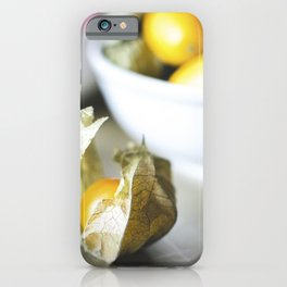 Cape gooseberries kumquats and lychees in the bowls iPhone Case