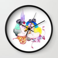 leah flores Wall Clocks featuring Flores by Tania Orozco