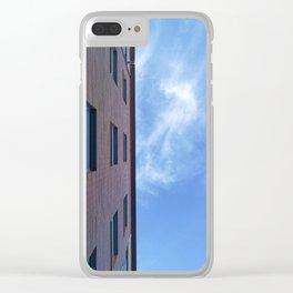 Facade of an urbanization building against a blue cloudy sky. Clear iPhone Case