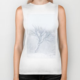 Lonely tree during snow storm in winter Biker Tank