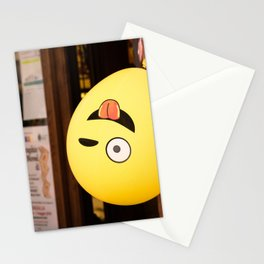 Yellow winking emoji balloon hangs upside down Stationery Cards