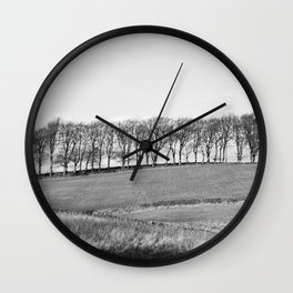 Trees on the horizon of a hill. Derbyshire, UK. Wall Clock