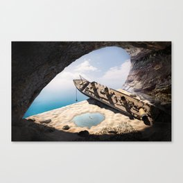 wrecked ship in the cave Canvas Print