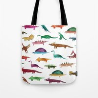 dinosaurs Tote Bags featuring dinosaurs by victoriazorus
