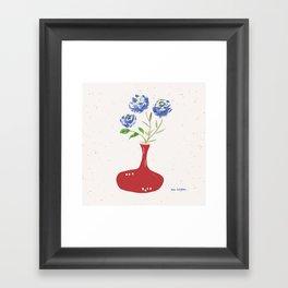 Blue roses in wine decanter Framed Art Print