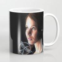 katniss Mugs featuring Katniss Everdeen  by drawingsbyignacio