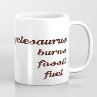 pocket fuel Mugs featuring Unicyclesaurus: Burning Fossil Fuel by Nomadic Concepts/Julia Shahin Collard