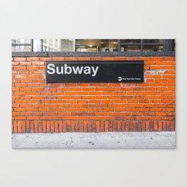 subway sign on a brick wall Canvas Print
