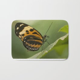 Melinaea ethra  butterfly on the leaf Bath Mat