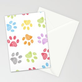Doodle colorful paw print seamless fabric design repeated pattern with white background Stationery Cards
