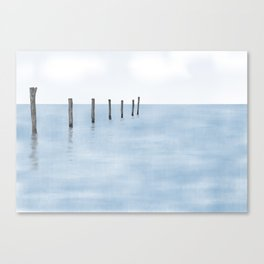 Abstract painted wooden pillars in the sea with reflections Canvas Print