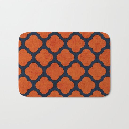 navy and orange clover Bath Mat