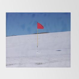 Red flag on Stromness golf course on a snowy April day. Throw Blanket