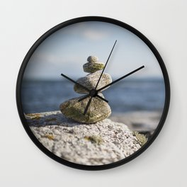 Pile of pebbles on a beach Wall Clock