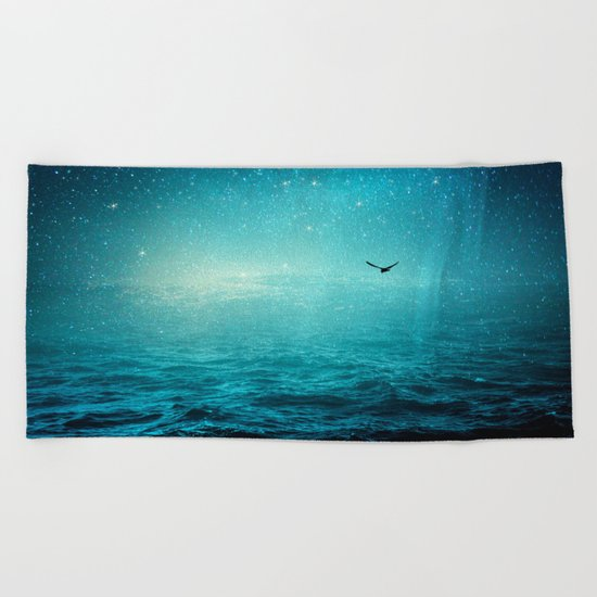 the sea and the universe Beach Towel