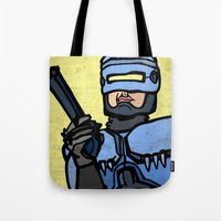 robocop Tote Bags featuring RoboCop by Rat McDirtmouth