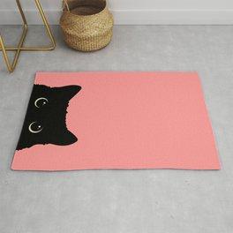 Sneaky black cat Rug