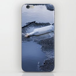 bottle garbage on melting ice iPhone Skin