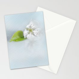 On the table lay the flower of a wild pear ... Stationery Cards