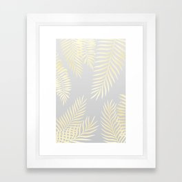 Gold palm leaves on grey Framed Art Print
