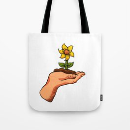 cartoon flower growing in palm of hand Tote Bag