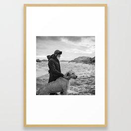 The man, the sea, the hound. Framed Art Print