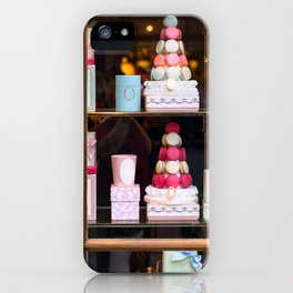 Beautiful colorful tasty macaroons cakes sweets and presents in the boxes display in window at the  iPhone Case
