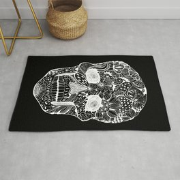 Human skull with hand- drawn flowers, butterflies, floral and geometrical patterns Rug