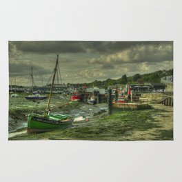 Boats at Leigh on sea Rug