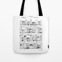 baloon Tote Bags featuring Cityscape from baloon flight by posterilla