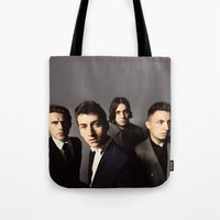 arctic monkeys Tote Bags featuring Arctic Monkeys by lastminutebinge
