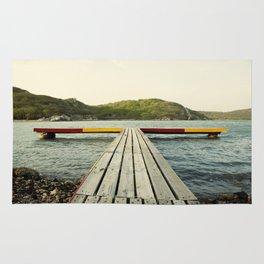 Pier in Caribbean lake Rug