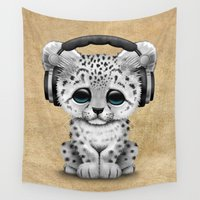 snow leopard Wall Tapestries featuring Cute Snow leopard Cub Dj Wearing Headphones  by Jeff Bartels