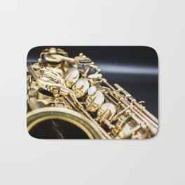 Alto saxophone black background Bath Mat