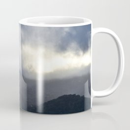 Light Streaming over mountains Coffee Mug