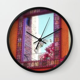 Reflection on a Mexican Wall Wall Clock